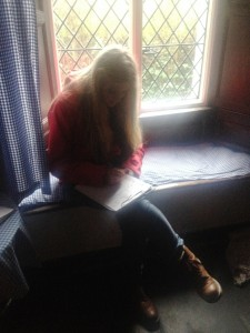 Lucy sat writing her poem in Dove Cottage