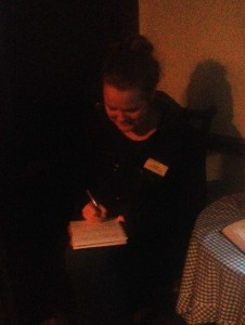 Hannah sat writing her poem by the Dove Cottage firelight